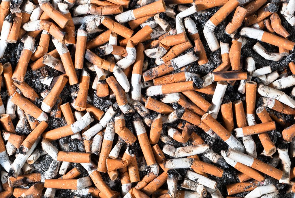 Many filter cigarette butts background — Stock Photo #8815692