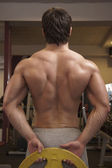 Bodybuilder is back in the gym — Stock Photo