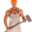 Young and handsome builder with a sledgehammer and sexy body — Stock Photo
