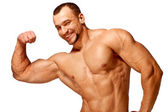Muscular male torso of bodybuilder on white background — Stock Photo