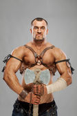 Muscular male portrait of ancient warrior — Stock Photo