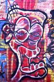 Graffiti head on brick wall — Stock Photo