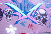 Graffiti wall with skulls — Stock Photo