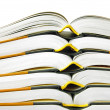 Pile of open books in closeup over white background — Stock Photo