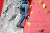 Child climbing on a wall in a climbing center — Stock Photo