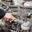 Checking engine oil dipstick in the car — Stock Photo