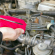 Stock Photo: Checking engine oil dipstick in the car