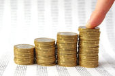 Hand put coin to money staircase isolated on on background with — Stock Photo
