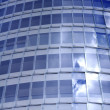 Stock Photo: Business building windows and sky reflection