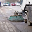 Stock Photo: Sweeping machine cleans street