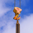 Metal crane Hook on a blue sky — Stock Photo #9051655