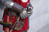 Gloves and weapons of a knight — Stock Photo