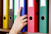 Folder with archival documents and a hand — Stock Photo