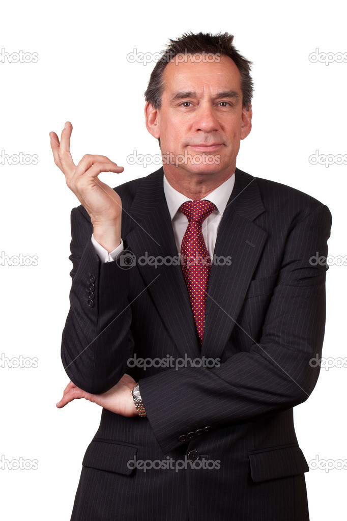 Attractive Smiling Middle Age Business Man in Suit Gesturing with Hand Isolated — Stock Photo #8789843