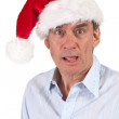 Stock Photo: Shocked Surprised Business Man in Santa Hat
