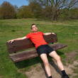 Tired Middle Age MExercising and Resting on Sunny Park Bench — Stock Photo #8858599