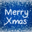 Christmas Blue Background with Merry Xmas Text in Snow Writing — Stock Photo