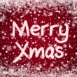 Christmas Red Background with Merry Xmas Text in Snow Writing — Stock Photo #8859590