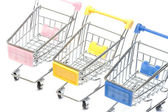 Shopping carts on white, closeup — Stock Photo
