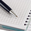 Stock Photo: Blue pen with notebook closeup
