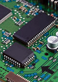 Microchips on circuit board — Stock Photo