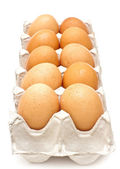 Brown eggs in a carton package on white background — Stock Photo
