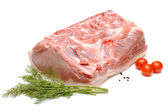 Piece of pork and vegetables on white — Stock Photo