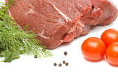 Piece of beef and vegetables on white — Stock Photo