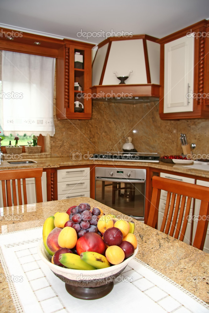 Interior of a modern kitchen with fruit — Stock Photo #8938856