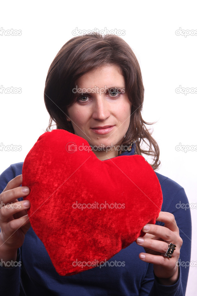 Beautiful woman holding a love symbol in hands — Stock Photo #8938923