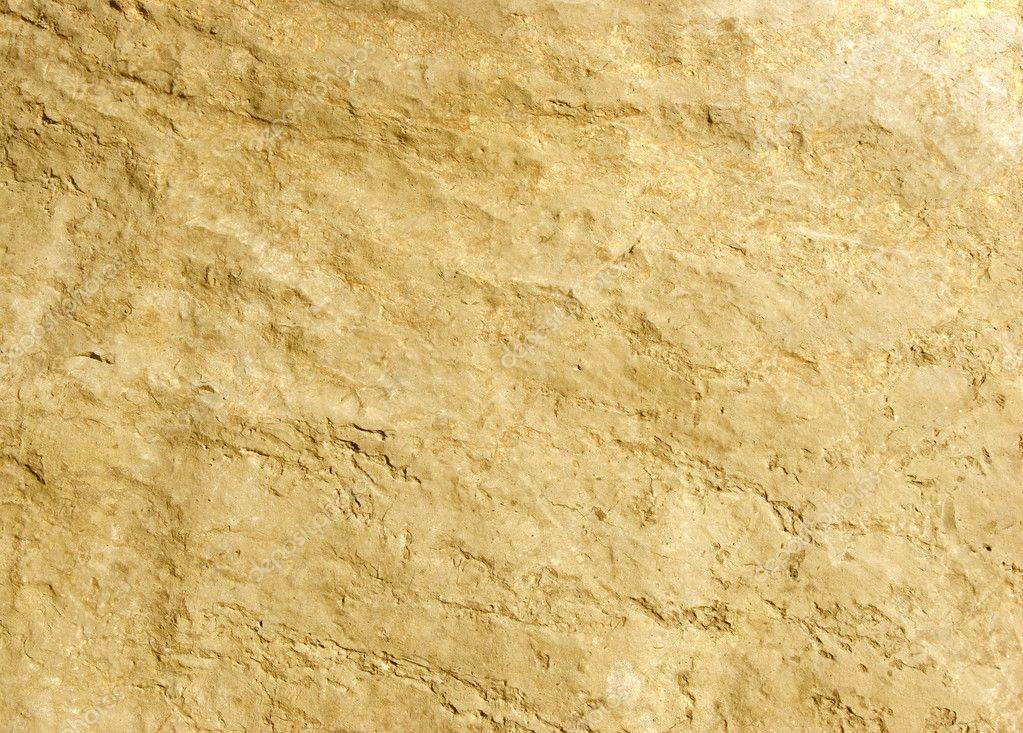 Gold rock texture shot close-up at shallow dof. — Stock Photo #8742289