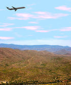 Airplane Over Desert — Stock Photo