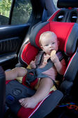 A child in the car seat — Stock Photo