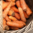 Royalty-Free Stock Photo: Fresh organic carrots in a wooden