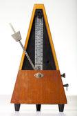 Musical metronome on a white — Stock Photo