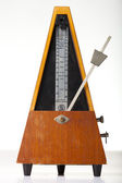 Musical metronome on a white — Stock Photo