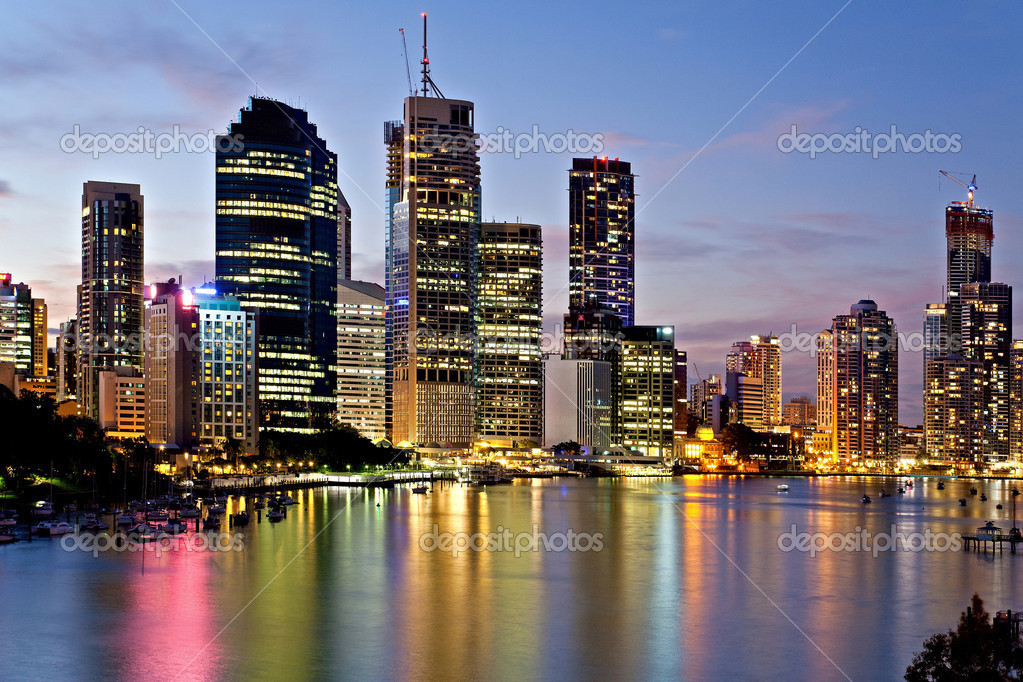 Brisbane city reflected in the river at sunset with colored lights — Stock Photo #8745710