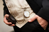 Pocket watch on the waist coat of a groom — Stock Photo