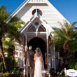 Father standing with bride outside a church — Stock Photo