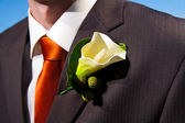Close up of a lily corsage on a groom — Stock Photo