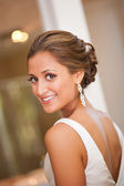 Beautiful bride looking over her shoulder — Stock Photo