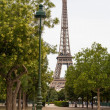 Lamppost with Eiffel tower in the background — Stock Photo