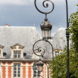 Stock Photo: Ornate lampposts at places du Vosages in Paris