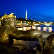 Alexander III bridge at night and Eiffel tower — Stock Photo #9060366