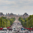 View down the Champs Elysees towards Grand palace - Stock Photo