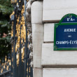 Stock Photo: Champs Elysees street sign on pillar
