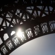 Eiffel tower detail showing patterns and sun — Stock Photo #9060379