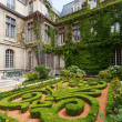 Beautiful ornate gardens of Carnavalet museum - Stock Photo