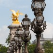 Ornate lampposts on Alexander III bridge in Paris — Stock Photo