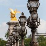 Ornate lampposts on Alexander III bridge in Paris — Stock Photo